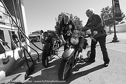 Dottie Mattern fills up her 1936 Indian Scout with Ron Roberts and his 1936 Indian Chief during Stage 15 (244 miles) of the Motorcycle Cannonball Cross-Country Endurance Run, which on this day ran from Lewiston, Idaho to Yakima, WA, USA. Saturday, September 20, 2014.  Photography ©2014 Michael Lichter.