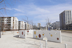 Playground surrounded by modern buildings in city, Munich, Bavaria, Germany