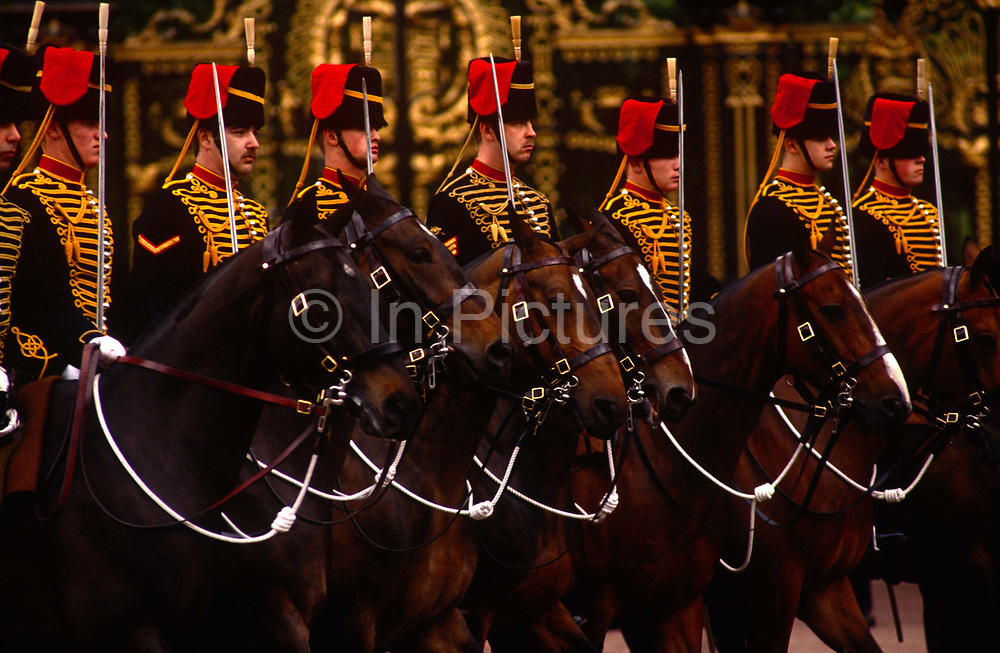 A row or Royal Artillery horsemen during the annual Trooping of the Colour parade in the Mall. With swords drawn, the row of fine horse mounted soldiers parade along the Mall towards the parade ground at Horseguards. The Royal Regiment of Artillery, commonly referred to as the Royal Artillery (RA), is the artillery arm of the British Army. Despite its name, it comprises a number of regiments. The introduction of artillery into the English Army came as early as the Battle of Crécy in 1346