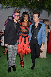 Left to right, HENRY HOLLAND, NAOMI CAMPBELL and NICK GRIMSHAW at the Glamour Women of The Year Awards in Association with Next held in Berkeley Square Gardens, Berkeley Square, London on 3rd June 2014.
