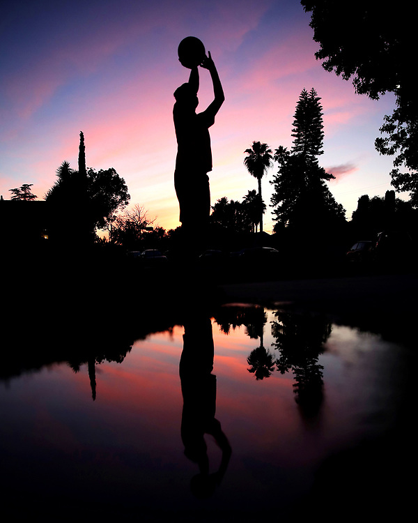 Sean Mulcahy plays basketball in his front yard on May 8, 2020 in Van Nuys, California.