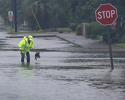 A city employee works to clear storm drains on flooded Isabella Street in the downtown area as Hurricane Irma moves through the city on Monday, September 11, 2017, in Waycross, GA, USA. Photo by Curtis Compton/Atlanta Journal-Constitution/TNS/ABACAPRESS.COM