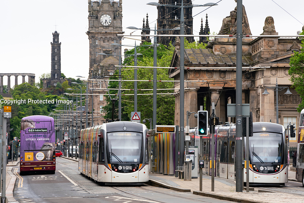 View of Trams and buses on Princes Street in Edinburgh, Scotland, UK