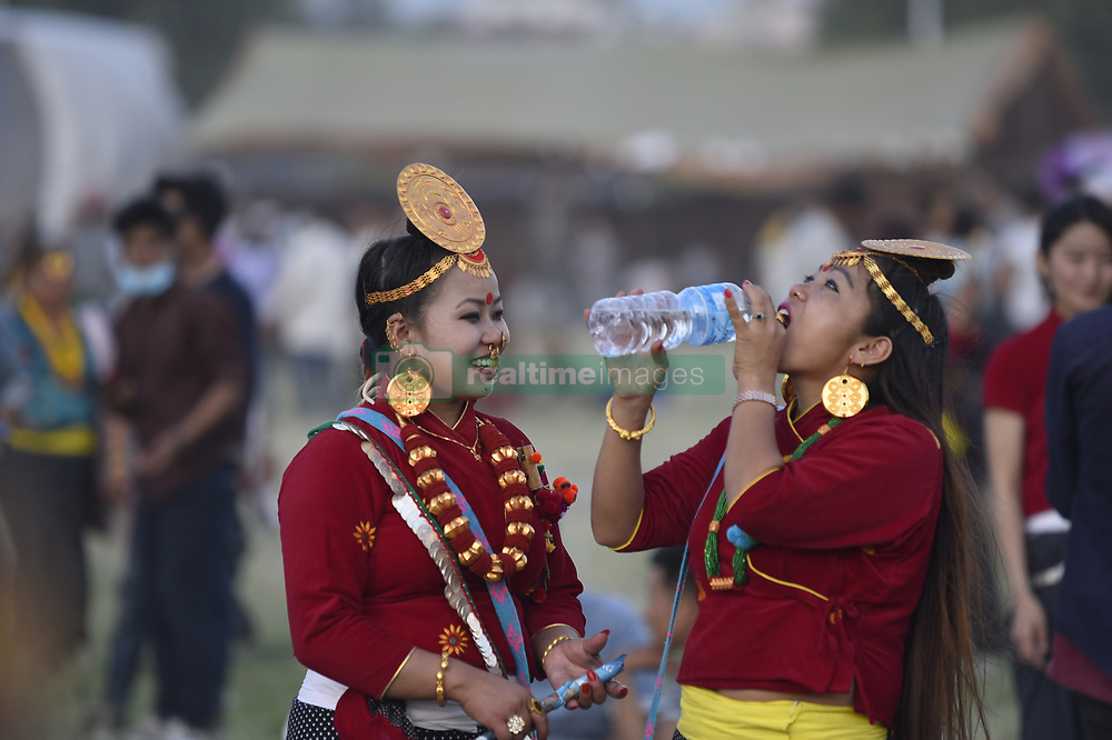 May 25, 2019 - Kathmandu, NP, Nepal - Nepalese girl from Kirant community in traditional attire drinks water as arrives to celebrate Ubhauli, a cultural festival of Kirant in Kathmandu, Nepal on Saturday, May 25, 2019. According to the Kiranti tradition, Ubhauli is celebrated before cultivating crops by praying for good harvest. (Credit Image: © Narayan Maharjan/NurPhoto via ZUMA Press)
