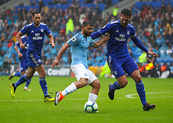 September 22, 2018 - Cardiff City, England, United Kingdom - Sergio Aguero of Manchester City shoots at goal while under pressure from Sean Morrison of Cardiff City during the Premier League match between Cardiff City and Manchester City at Cardiff City Stadium,  Cardiff, England on 22 Sept 2018. (Credit Image: © Action Foto Sport/NurPhoto/ZUMA Press)
