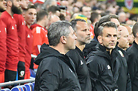 Football - 2018 / 2019 UEFA Nations League B - Group Four: Wales vs. Republic of Ireland<br /> <br /> Wales manager Ryan Giggs with his coaching staff for the anthems , at Cardiff City Stadium.<br /> <br /> COLORSPORT/WINSTON BYNORTH
