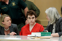 May 1, 2019 - Fort Lauderdale, Florida, U.S. - Parkland school shooting suspect NIKOLAS CRUZ in court at the Broward Courthouse in Fort Lauderdale for a motion filed by the Public Defender's Office to withdraw from the case due to Cruz receiving an inheritance that can be used to pay for a private attorney. Defense attorney Melisa McNeill and Diane Cuddihy speak with their client. (Credit Image: © TNS via ZUMA Wire)