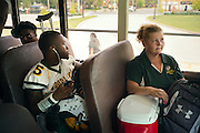 """BIRMINGHAM, AL – SEPTEMBER 11, 2015: Sonya Whitaker (right) sits near Woodlawn receiver Quintarius Monroe (center) on the way to a high school football game. """"I tray to stay back and let him come to me if he gets in trouble. I'm diabetic too."""" As a type 1 diabetic, Quintarius Monroe requires frequent blood sugar testing and supervision when self-administering insulin. When care from qualified personnel at his school in Center Point became unavailable, Monroe was forced to transfer several miles away from his locally zoned school to attend Woodlawn High School. The Americans with Disabilities Act requires schools to provide """"reasonable accommodation"""" for students with medical conditions, but given that most schools no longer retain school nurses, many schools are failing to provide adequate care for their students.<br /> CREDIT: Bob Miller for The New York Times"""