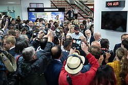 © Licensed to London News Pictures . 22/09/2019. Brighton, UK. Labour leader JEREMY CORBYN walks through the exhibition at the conference and is surrounded by media and supporters , during the second day of the 2019 Labour Party Conference at the Brighton Centre . Photo credit: Joel Goodman/LNP