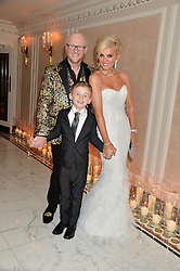 JOHN CAUDWELL and CLAIRE CAUDWELL with their son JACOBI CAUDWELL at a birthday dinner for Claire Caudwell for family & friends held at The Dorchester, Park Lane, London on 24th January 2014.