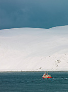 A fishing trawler sails in the waters of Finnmark region, in northern Norway