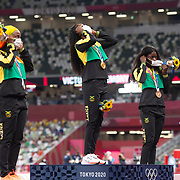 TOKYO, JAPAN August 1: Elaine Thompson-Herah of Jamaica on the podium with her gold medal, Shelly-Ann Fraser-Pryce of Jamaica with her silver medal and <br /> Shericka Jackson of Jamaica with her bronze medal after the 100 Final for women during the Track and Field competition at the Olympic Stadium  at the Tokyo 2020 Summer Olympic Games on July 31, 2021 in Tokyo, Japan. (Photo by Tim Clayton/Corbis via Getty Images)