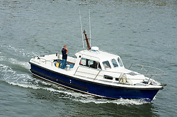 Mitchell 31 MKII Fishing and leisure boat sails in to Whitby harbor.September 2010 .Images © Paul David Drabble