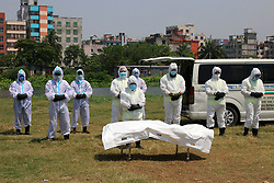 """April 7, 2020, Dhaka, Bangladesh: With great respect and care a team of gravediggers and health workers, dressed in full protective suits, say final words and bury the body of coronavirus victim, JALAL SAIFUR RAHMAN, the director of the Banglandish Anti-Corruption Commission (ACC). Jalal, a director of Bangladesh government's main anti-graft body, had tested positive for COVID-19 seven days ago. Dr. Shihab Uddin, superintendent of Kuwait Bangladesh Friendship Government Hospital, one of the dedicated hospitals for treating coronavirus-infected patients in Bangladesh, said: """"He was in a intensive care unit of the hospital and last late night his blood pressure fell down rapidly. We tried our level best. But today [Monday] at 7.30 a.m. he died."""" Bangladesh on Monday, reported 29 new coronavirus patients and four new deaths, raising the total number of confirmed cases in the country to 123 and death toll to 13. Since appearing in Wuhan, China last December, the novel coronavirus has spread to at least 183 countries and regions, killed scores and infected millions. (Credit Image: © Sultan Mahmud Mukut/SOPA Images via ZUMA Wire)"""