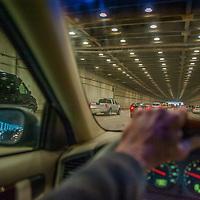 A driver speeds east through a tunnel on Yerba Buena Island, half way across the Bay Bridge between San Francisco and Oakland, California.