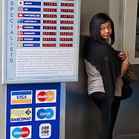 MILAN, ITALY - JUNE 07:  A tourist is seen queuing at a Change office in the central Piazza del Duomo on June 7, 2010 in Milan, Italy. Today the Italian stock market suffered new losses in particular the banking sector and the Euro falls below $1.19, the lowest in over 4 years  (Photo by Marco Secchi/Getty Images)