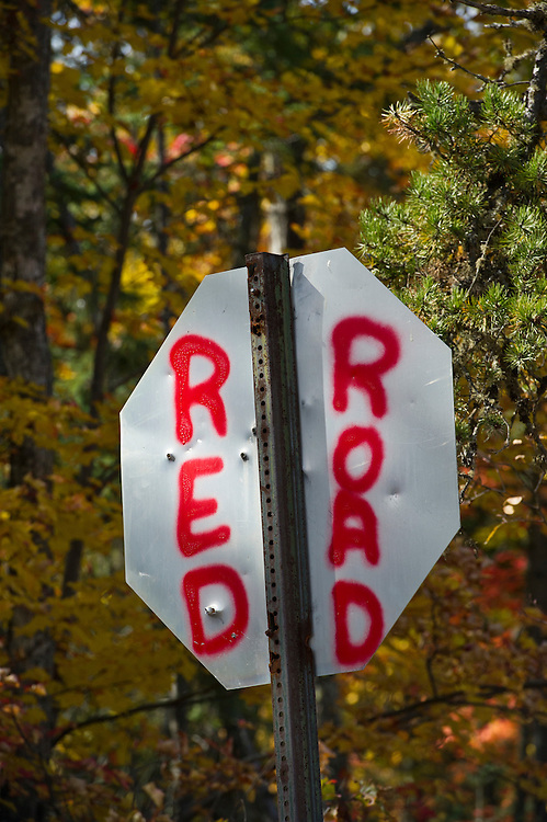 Spray paint marks the Red Road on the back of a stop sign in Marquette County Michigan's Upper Peninsula.