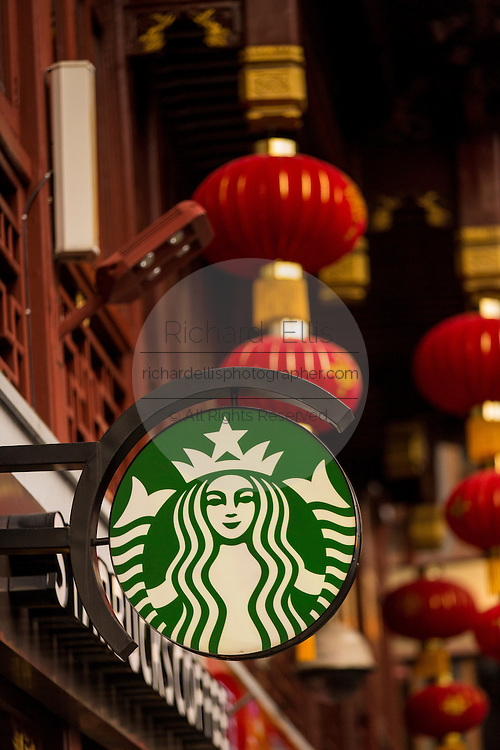 A sign for Starbucks store in the historic Yu Yuan Bazaar Shanghai, China