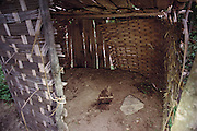 Namgay family pit toilet in Shingkhey, Bhutan, was part of a program mandated by the country's king to force the Bhutanese to use a specific location for toileting. This program has not been a success. Most families still use the surrounding bushes and fields. Published in Material World: A Global Family Portrait, Toilets of the World page 225.