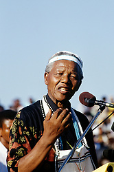 NELSON ROLIHLAHLA MANDELA (July 18, 1918 - December 5, 2013), 95, world renown civil rights activist and world leader. Mandela emerged from prison to become the first black President of South Africa in 1994. As a symbol of peacemaking, he won the 1993 Nobel Peace Prize. Joined his countries anti-apartheid movement in his 20s and then the ANC (African National Congress) in 1942. For next 20 years, he directed a campaign of peaceful, non-violent defiance against the South African government and its racist policies and for his efforts was incarcerated for 27 years. Remained strong and faithful to his cause, thru out his life, of a world of peace. Transforming the world, to make it a better place. PICTURED: 1994 - Nelson Mandela, South Africa - NELSON MANDELA addresses a crowd in the former Transkei dressed in traditional Xhosa beads.  (Credit Image: © Greg Marinovich/ZUMA Wire/ZUMAPRESS.com)