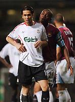 Photo: Daniel Hambury.<br />West Ham United v Liverpool. The Barclays Premiership. 26/04/2006.<br />West Ham's Nigel Reo-Coker shows Liverpool's Luis Garcia the way off the picth.