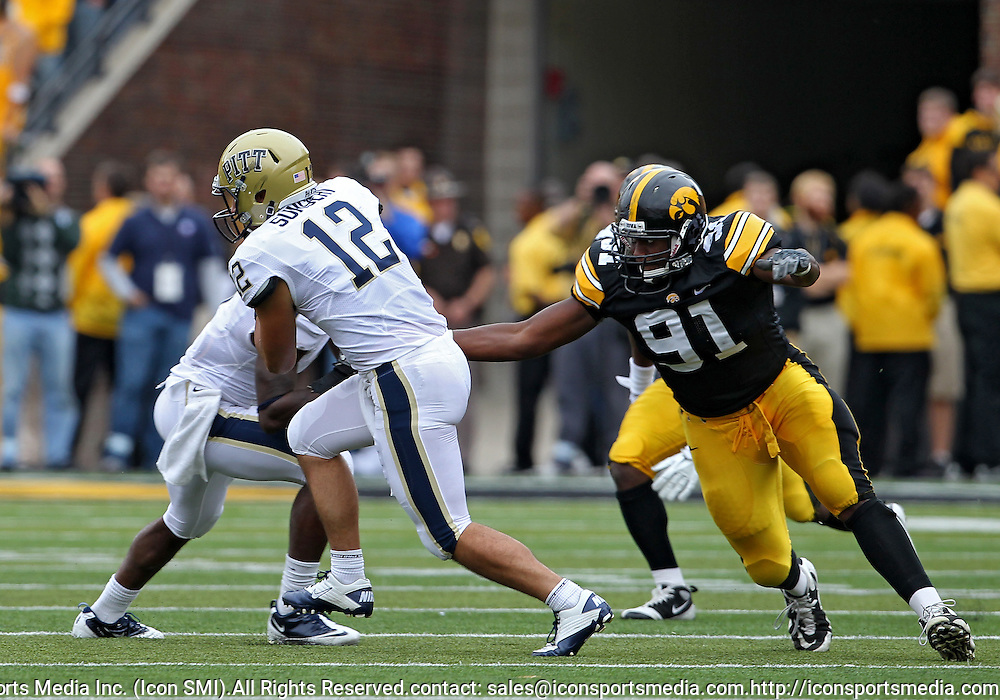 September 17, 2011: Iowa Hawkeyes defensive lineman Broderick Binns (91) tries to grab Pittsburgh Panthers quarterback Tino Sunseri (12) during the second half of the game between the Iowa Hawkeyes and the Pittsburgh Panthers at Kinnick Stadium in Iowa City, Iowa on Saturday, September 17, 2011. Iowa defeated Pittsburgh 31-27.