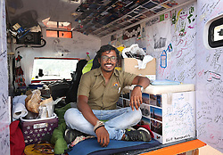 Naveen Rabelli inside his solar-powered tuk tuk after arriving at Dover Docks at the end of a seven-month, 6,200 mile overland adventure from India.