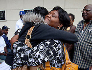 """Family of slain """"grim Sleeper"""" suspects hug outside the press conference.<br /> LAPD and city officials hold a press conference to announce the capture of the """"Grim Sleeper"""" serial murder suspect, Lonnie David Franklin jr.<br /> Franklin will be charged with 10 counts of murder, and one count of attempted later today."""