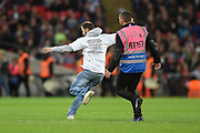 A fan invades the pitch during the FIFA World Cup Qualifier match between England and Slovenia at Wembley Stadium, London, England on 5 October 2017. Photo by Martin Cole.