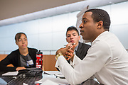 Purchase, NY – 31 October 2014. Morgan Stanley facilitator Michael O talking to the team from Alexander Hamilton High School. Alexander Hamilton High School placed third in the 2014 competition. The Business Skills Olympics was founded by the African American Men of Westchester, is sponsored and facilitated by Morgan Stanley, and is open to high school teams in Westchester County.