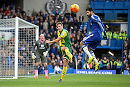 Ryan Bennett of Norwich City kicks the ball over Diego Costa of Chelsea. Barclays Premier league match, Chelsea v Norwich city at Stamford Bridge in London on Saturday 21st November 2015.<br /> pic by John Patrick Fletcher, Andrew Orchard sports photography.