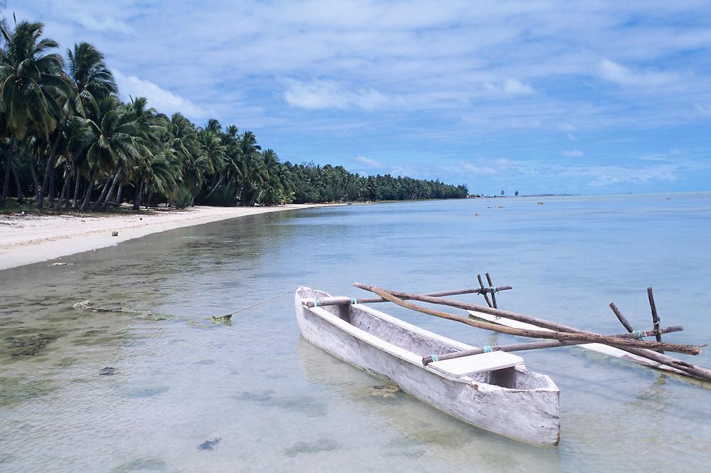 Cook Islands, K?ki '?irani, South Pacific Ocean, Aitutaki coastal scenic, canoe in foreground