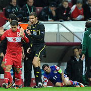 Referee's Felix BRYCH (2ndL) and Turkey's Emre BELOZOGLU (L) during their UEFA EURO 2012 Play-off for Final Tournament First leg soccer match Turkey betwen Croatia at TT Arena in Istanbul Nüovember11, 2011. Photo by TURKPIX