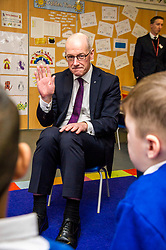 Pictured: John Swinney joined in with the primary ones who invited the Deputy First Minister to attend their nativity play that afternoon.<br /> Today Deputy First Minister John Swinney visited Niddrie Mill Primary School to announce the publication of Scottish school statistics such as teacher numbers, ratios and class sizes. <br /> <br /> <br /> Ger Harley   EEm 12 December 2017