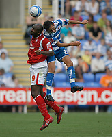 Photo: Steve Bond/Richard Lane Photography. Reading v Nottingham Forest. Coca Cola Championship. 08/08/2009. Dele Adebola (L) and Jem Karacan clash in the air.  Jem karacan is injured in the process