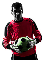 one  soccer player goalkeeper man standing holding ball in silhouette isolated white background