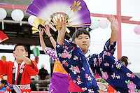 """Children onstage take the lead in demonstrating """"bon odori"""" dances during Sunday's 63rd annual Obon Festival at the Buddhist Temple of Salinas."""