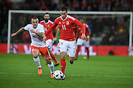 Tom Lawrence of Wales (11) breaks away from Jordy Clasie of the Netherlands. Vauxhall International football friendly, Wales v The Netherlands at the Cardiff city stadium in Cardiff, South Wales on Friday 13th November 2015. pic by Andrew Orchard, Andrew Orchard sports photography.