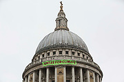 Activists from Africans Rising UK drop a banner from St Pauls Cathedral on the anniversary of the assassination of the Pan-Africanist President of Burkina Faso Thomas Sankara to launch the Jubilee for Climate Campaign on 15th October 2021 in London, United Kingdom. The Jubilee for Climate Campaign is an umbrella campaign both for the cancellation of debts for which Sankara fought so hard as well as for progressive and unifying policies to tackle the climate crisis which amplify voices from the Global South.