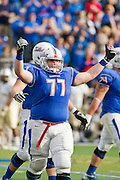 Dec 1, 2012; Tulsa, Ok, USA; Tulsa Hurricanes offensive guard Jake Alexander (77) reacts to a play during a game against the University of Central Florida Knights at Skelly Field at H.A. Chapman Stadium. Tulsa defeated UCF 33-27 in overtime to win the CUSA Championship. Mandatory Credit: Beth Hall-USA TODAY Sports