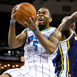 December 17, 2010; New Orleans, LA, USA; New Orleans Hornets guard Marcus Thornton (5) shoots and scores past Utah Jazz center Francisco Elson (16) during the second half at the New Orleans Arena.  The Hornets defeated the Jazz 100-71. Mandatory Credit: Derick E. Hingle