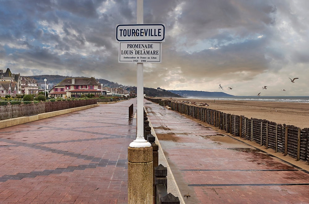 By The Sea - Tourgeville Normandy - colour documentary photo art by PAUL WILLIAMS  of the seaside town of tourgeville in winter. Taken in 2007 .<br /> <br /> Visit our REPORTAGE & STREET PEOPLE PHOTO ART PRINT COLLECTIONS for more wall art photos to browse https://funkystock.photoshelter.com/gallery-collection/People-Photo-art-Prints-by-Photographer-Paul-Williams/C0000g1LA1LacMD8