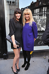 Left to right, JO WOOD and ANNABELLE NEILSON at a private view of Russell Young's work entitled American Envy held at Scream Gallery, 34 Bruton Street, London on 7th April 2011.