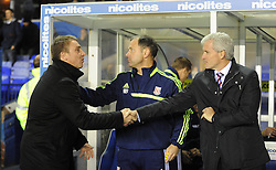 Birmingham City Manager, Lee Clark shakes Stoke City Manager, Mark Hughes hand prior to kick off.- Photo mandatory by-line: Alex James/JMP - Tel: Mobile: 07966 386802 29/10/2013 - SPORT - FOOTBALL - ST Andrew's - Birmingham - Birmingham City v Stoke City - Capital One Cup - Forth Round