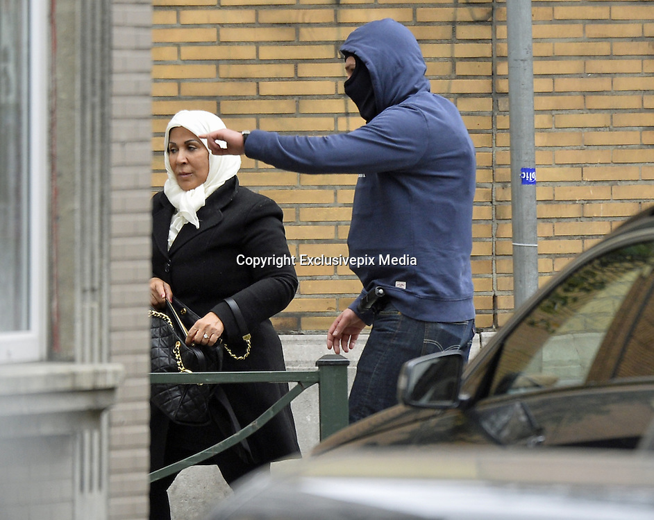 Nov. 16, 2015 - Brussels, BELGIUM - <br /> BRUSSELS, BELGIUM:<br /> <br /> Search for Paris Terror Suspect in Brussels<br /> <br /> Police escort a woman on the scene of searchings at a house in the Delaunoystraat - Rue Delaunoy in Sint-Jans-Molenbeek / Molenbeek-Saint-Jean, Brussels on Monday 16 November 2015. During the weekend searches were carried out and multiple people were arrested in relation to Friday's terrorist attacks in Paris. Several terrorist attacks in Paris, France, have left at least 129 dead and 350 injured. Most people were killed during a concert in venue Bataclan, the other targets were a restaurant and a soccer game. The attacks have been claimed by Islamic State.<br /> ©Exclusivepix Media
