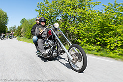 Hasse Wiklund riding his Harley-Davidson Twin-Cam Swedish style chopper with his daughter Frida on the Twin Club ride out from the club house in Norrtälje after their annual Custom Bike Show. Sweden. Sunday, June 2, 2019. Photography ©2019 Michael Lichter.