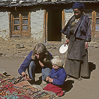 While trekking mother & son (MR) shop for artifacts from a shopkeeper beside the trail to Mount. Everest Base Camp in Sagarmatha National Park, Nepal.
