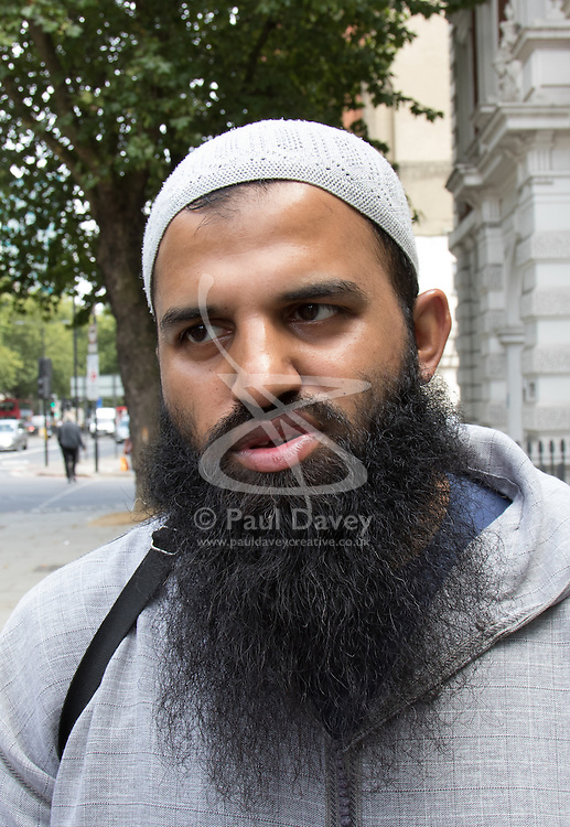 "Westminster Magistrates Court, London, August 5th 2015. Islamist Anjem Choudary is denied bail on terror charges at Westminster Magistrates Court. A colleague Mohammad Shamsuddin, also known as Abu Saalihah issued a press statement saying Choudary and his co-accused Mohammed Rahman will be remanded in custody until August 28th and declared the charges as part of an ongoing persecution of Muslims, declaring that ""one day the black flag of Islam WILL be flying over Westminster"". PICTURED: Close associate of Anjem Choudary Abdul Muhid arrives at Westminster Magistrates Court"