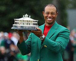 Tiger Woods holds the trophy after being presented the green jacket for winning the Masters at Augusta National Golf Club on Sunday, April 14, 2019, in Augusta, GA, USA. Photo byCurtis Compton/Atlanta Journal-Constitution/TNS/ABACAPRESS.COM