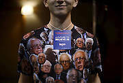 A volunteer at a U.S. Democratic presidential candidate Bernie Sanders' campaign event wears a shirt decorated with Sanders' image in Fort Dodge, Iowa, United States, January 19, 2016.   REUTERS/Jim Young